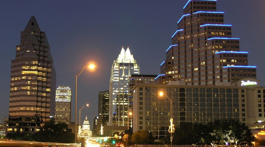 Downtown Austin at night featuring the Frost Tower and One Congress Plaza