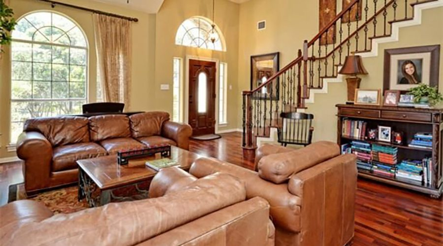 Interior shot of a living room and staircase in a luxury home