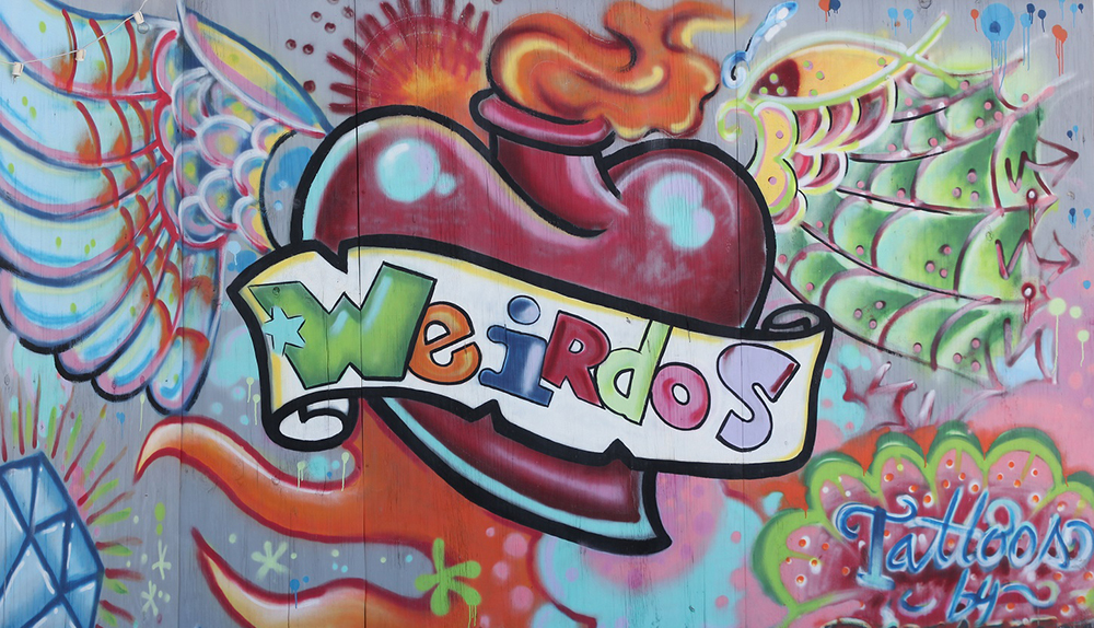 multi-colored mural that says 'weirdos'