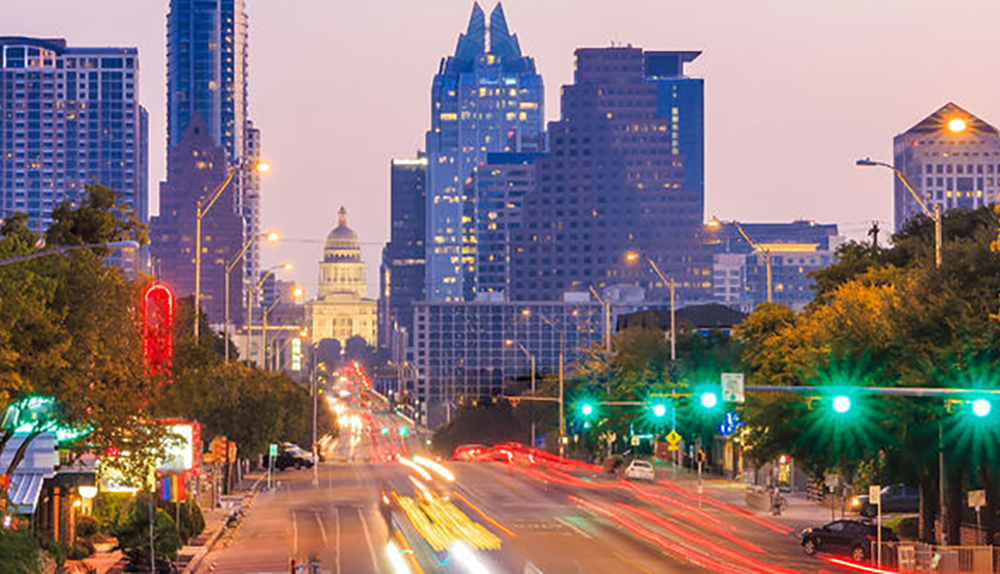 Congress Avenue in Austin, featuring the Frost Tower and the State Capitol