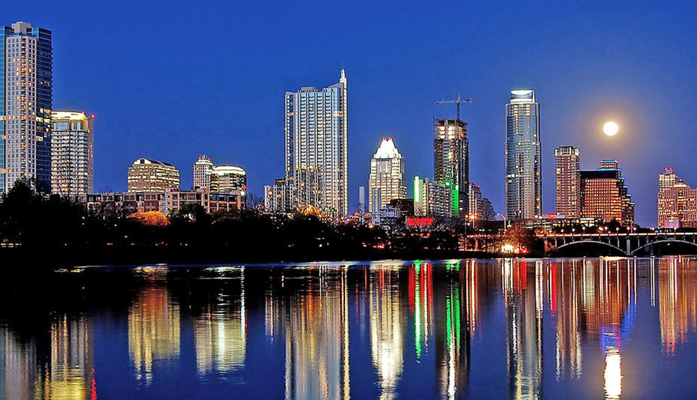 Downtown Austin skyline with Lady Bird Lake in the foreground with