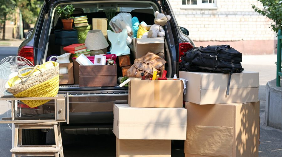 A station wagon filled with boxes in preparation for a move.