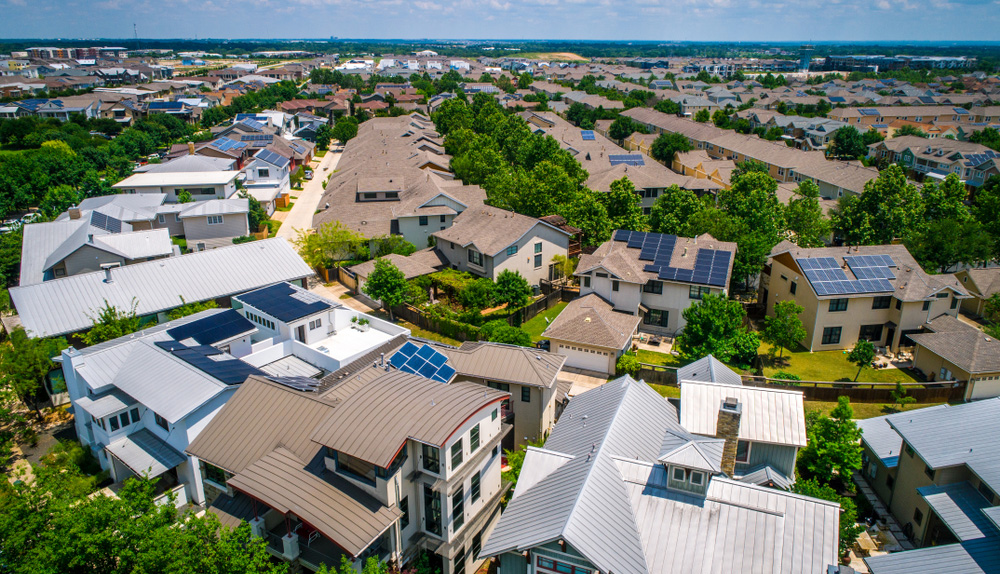 An overhead photograph of a planned community of energy efficient homes with solar panels
