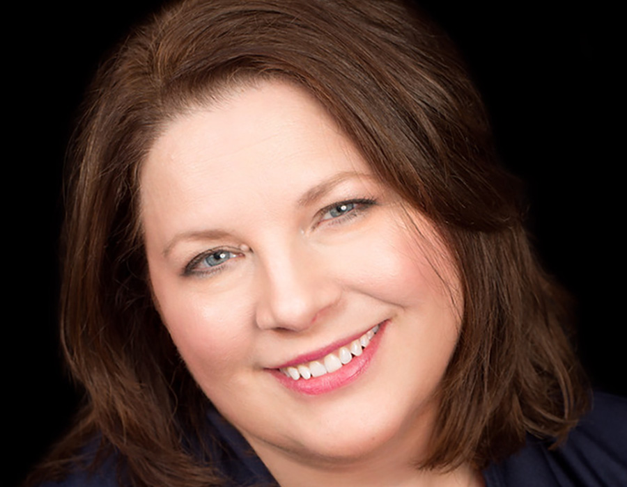 A headshot picture of Habitat Hunters Realtor Claudia Sparkman