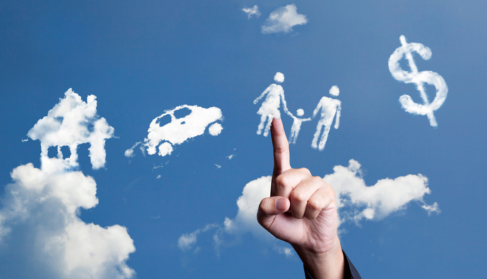 Image of a hand pointing to clouds shaped as people, a car, a home and a dollar symbol