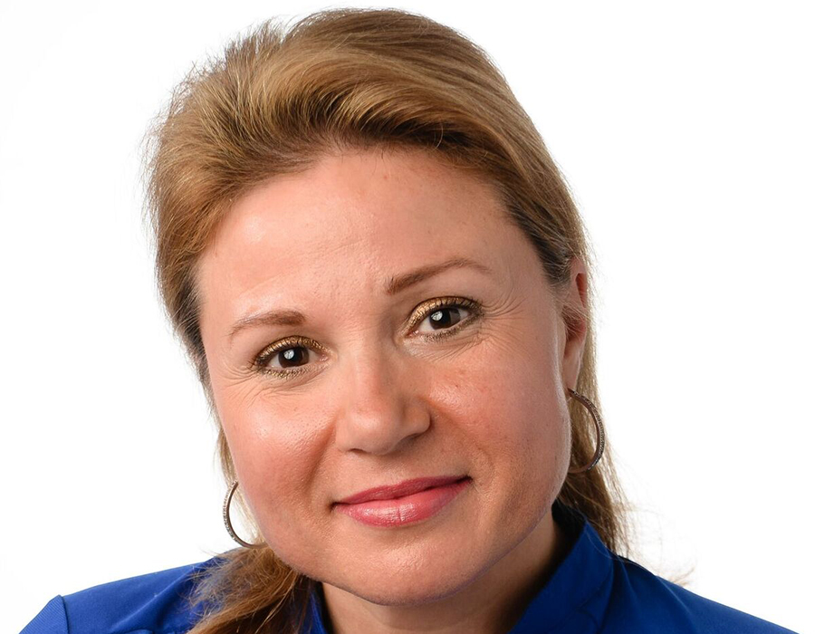 A headshot picture of Realtor Sheila Oettel