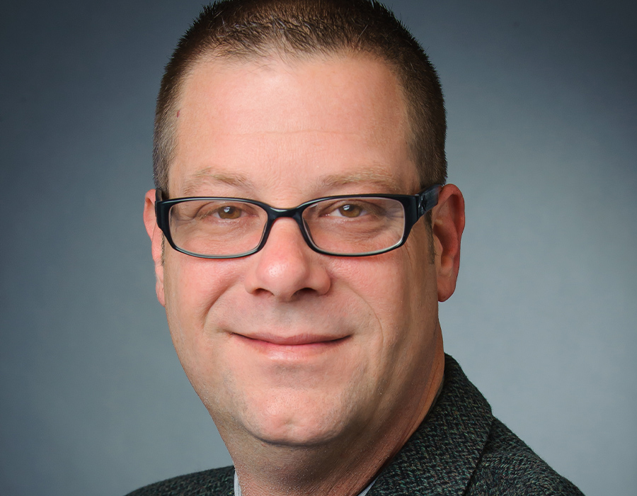 A headshot picture of Habitat Hunters Realtor TJ Ramsey