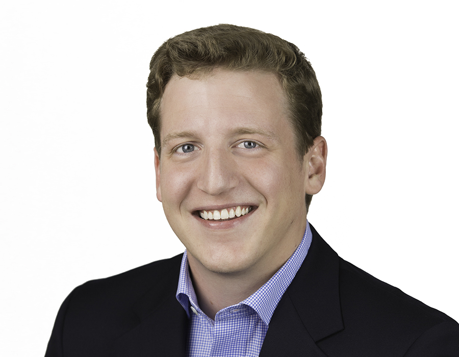 A headshot picture of Realtor Travis Saegert