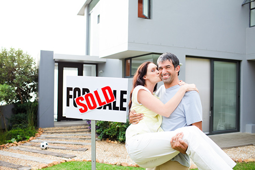 Photo of a happy couple who have just sold their house.
