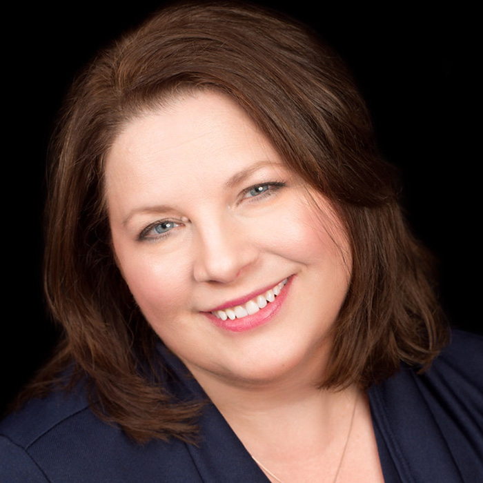A headshot picture of Realtor Claudia Sparkman