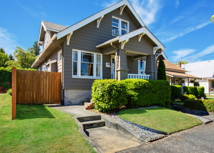A home with a perfectly maintained front yard