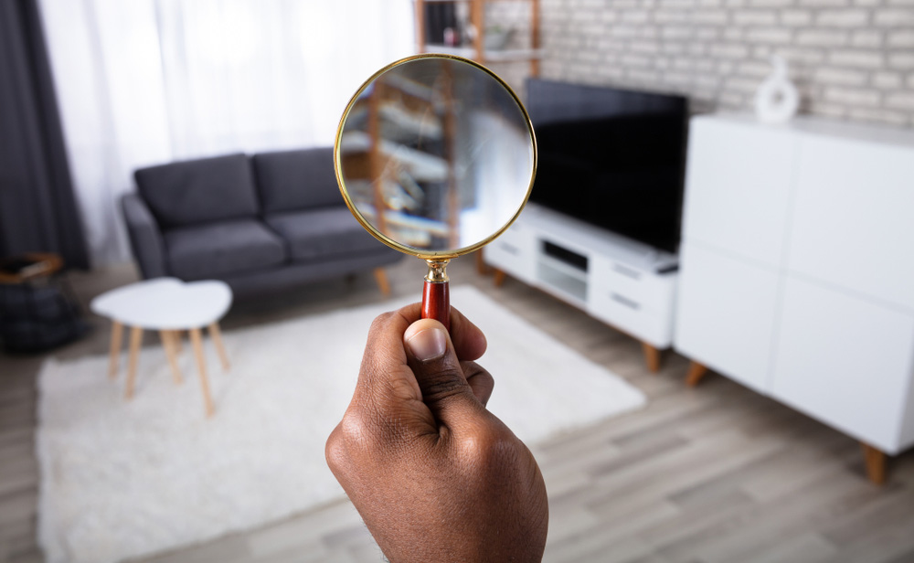 Perspective of looking at a home through a magnifying glass
